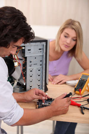 technician repairing computer photo