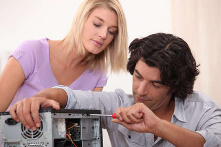 upgrading: Man fixing a computer