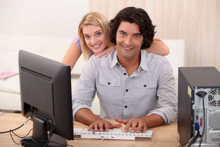 blonde haired: portrait of a couple with computer