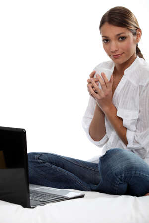 Woman with laptop and coffee photo