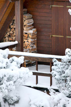 Wooden cabin in the snow photo