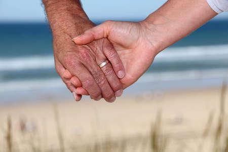 senior couple holding hands photo