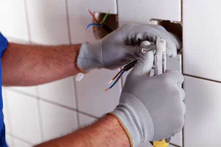conductivity: electrician cutting a cable