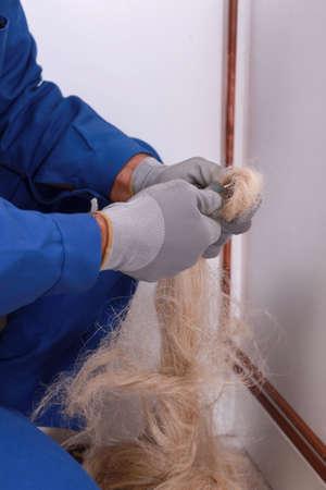 watertight: Plumber cutting flax