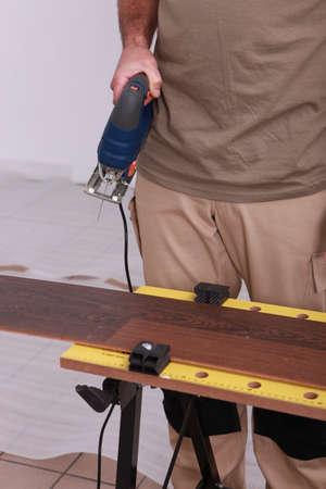 carpenter laying parquet Stock Photo - 22869447