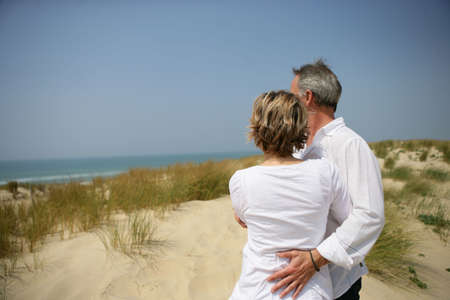 median age: Couple embracing in dune