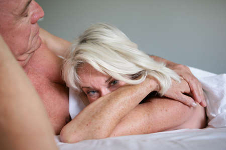 Older couple in bed photo