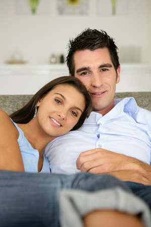 Couple relaxing on couch photo