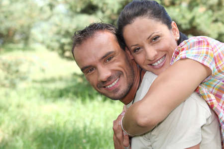 Playful couple in the park Stock Photo - 22879020