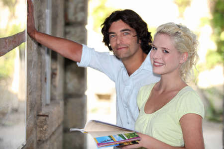 Couple looking at a tourist information board photo