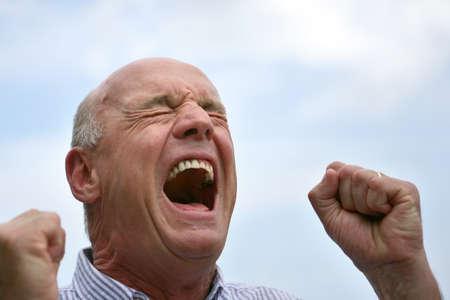 55 60 years: Senior screaming outdoors Stock Photo
