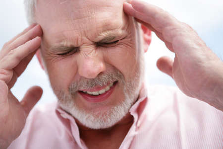 sore eye: Senior men with a migraine