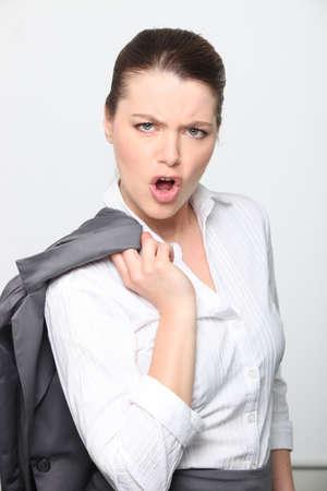 Young female executive giving attitude photo