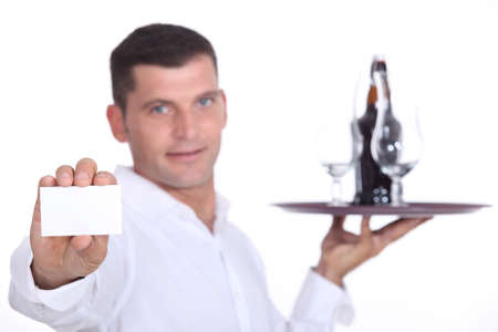 Waiter holding tray and business card photo
