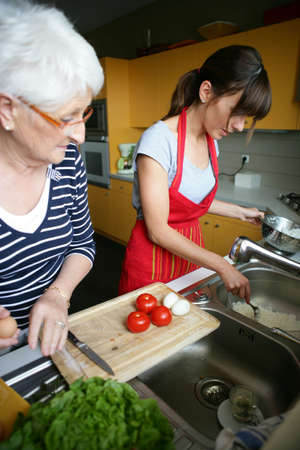 grandmother and granddaughter cooking photo