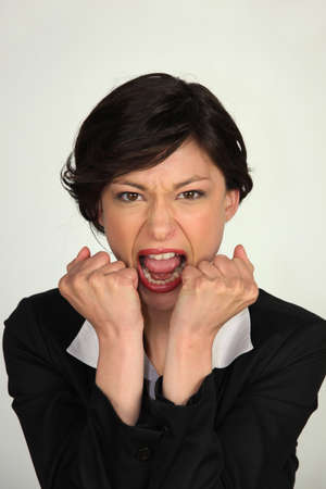anger management: Angry business woman Stock Photo