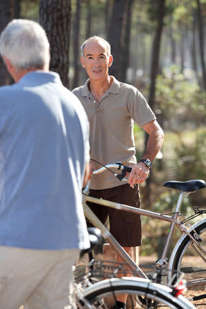 grey haired: Grey haired man on bike ride