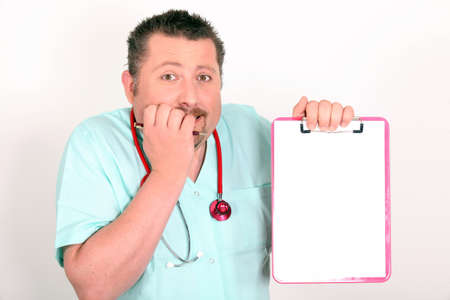 Male nurse looking scared holding notepad photo