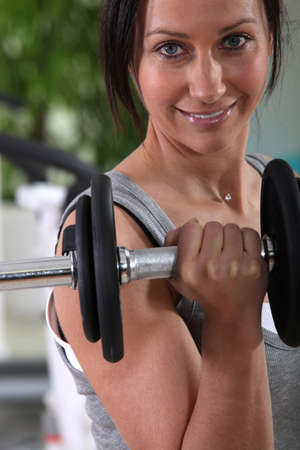 Woman working out with weights photo