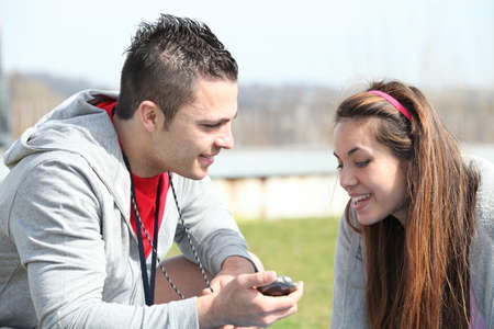 Couple reading a text message in a field photo