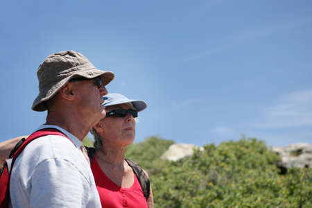 60 65 years: Senior couple hiking by the coast