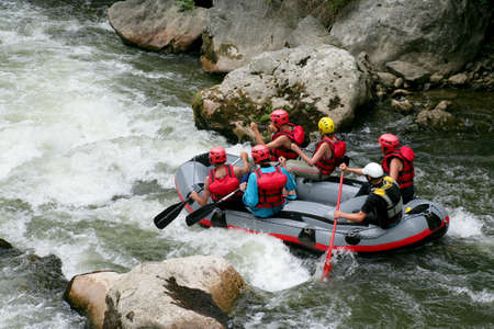 upstream: Thrill seekers rafting down rapids