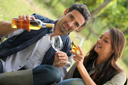 couple with drinks in the countryside photo