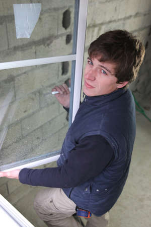 skilled labour: Worker installing new windows