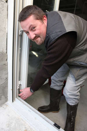Contractor fitting a new window photo