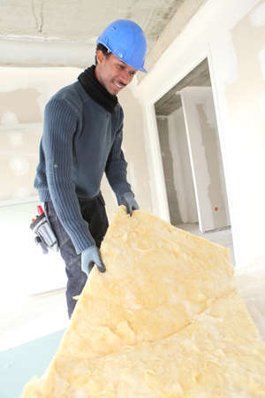 qualified worker: craftsman insulating Stock Photo