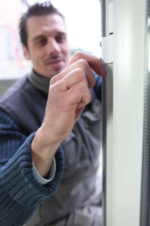 double glazing: Man fitting double glazing