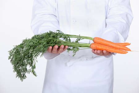 wight: Chef holding carrots