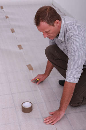 duct tape: Man protecting floor with ground sheet