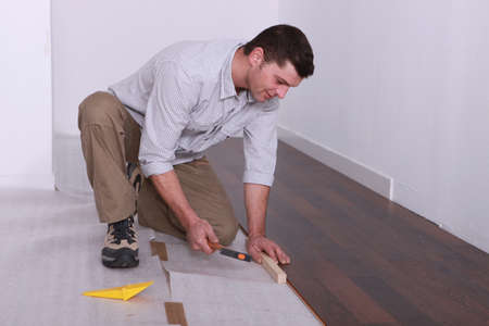 Man laying parquet photo