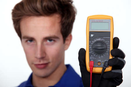 Electrician holding voltmeter photo