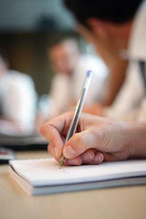 écrit à la main dans un carnet Banque d'images