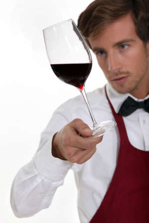Sommelier with a glass of red wine
