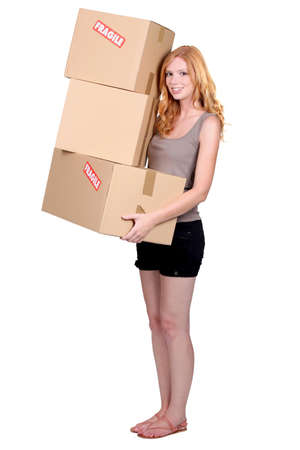 Redhead girl with cardboard moving photo