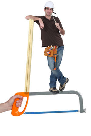Builder standing on a saw photo