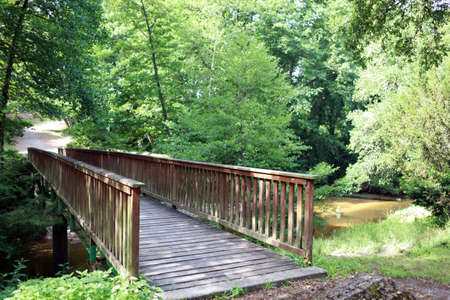 outside of the country: Wooden bridge over a stream
