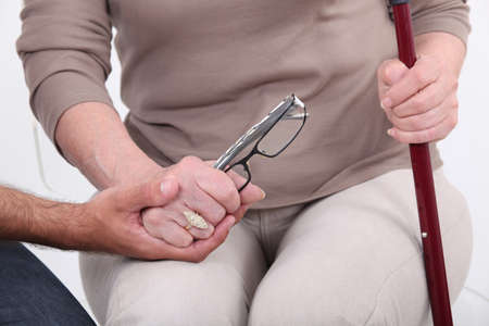 clutching: Man holding hands with an elderly lady