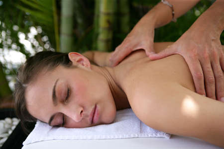 Woman receiving a shoulder massage Stock Photo - 23850404
