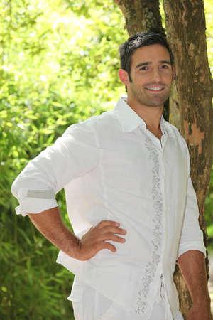Man posing by a tree Stock Photo - 23850401