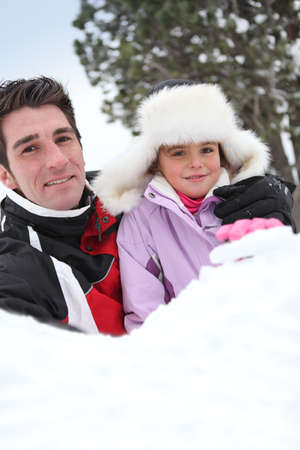 Father and daughter in the snow Stock Photo - 23850407
