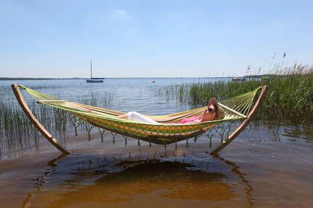 Woman relaxing in hammock Stock Photo - 23854329