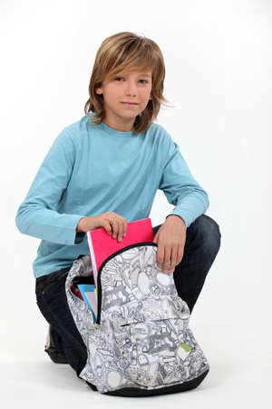 long haired: Long haired boy with his schoolbag