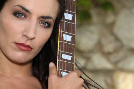 Woman with her guitar photo