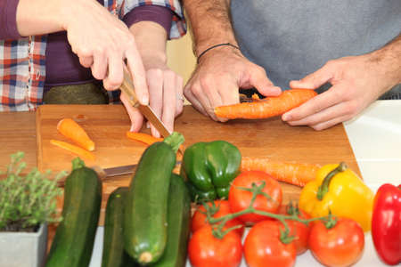 Couple chopping vegetables photo