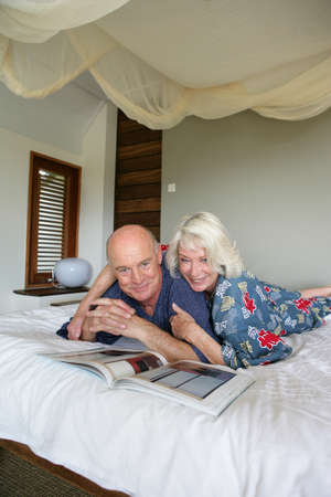 50 55 years: senior couple resting in bed Stock Photo