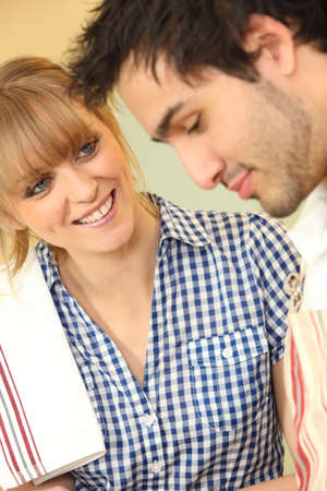 Man and woman with tea towel photo
